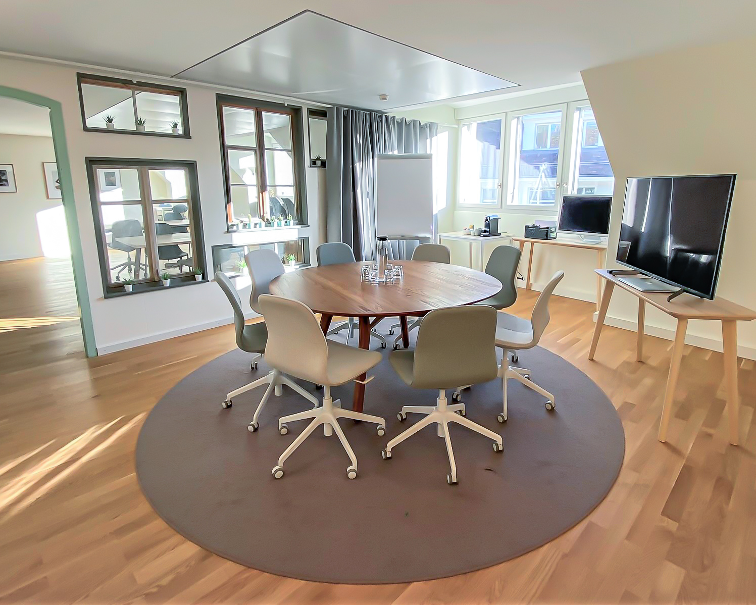 Meeting room with round table and big screen