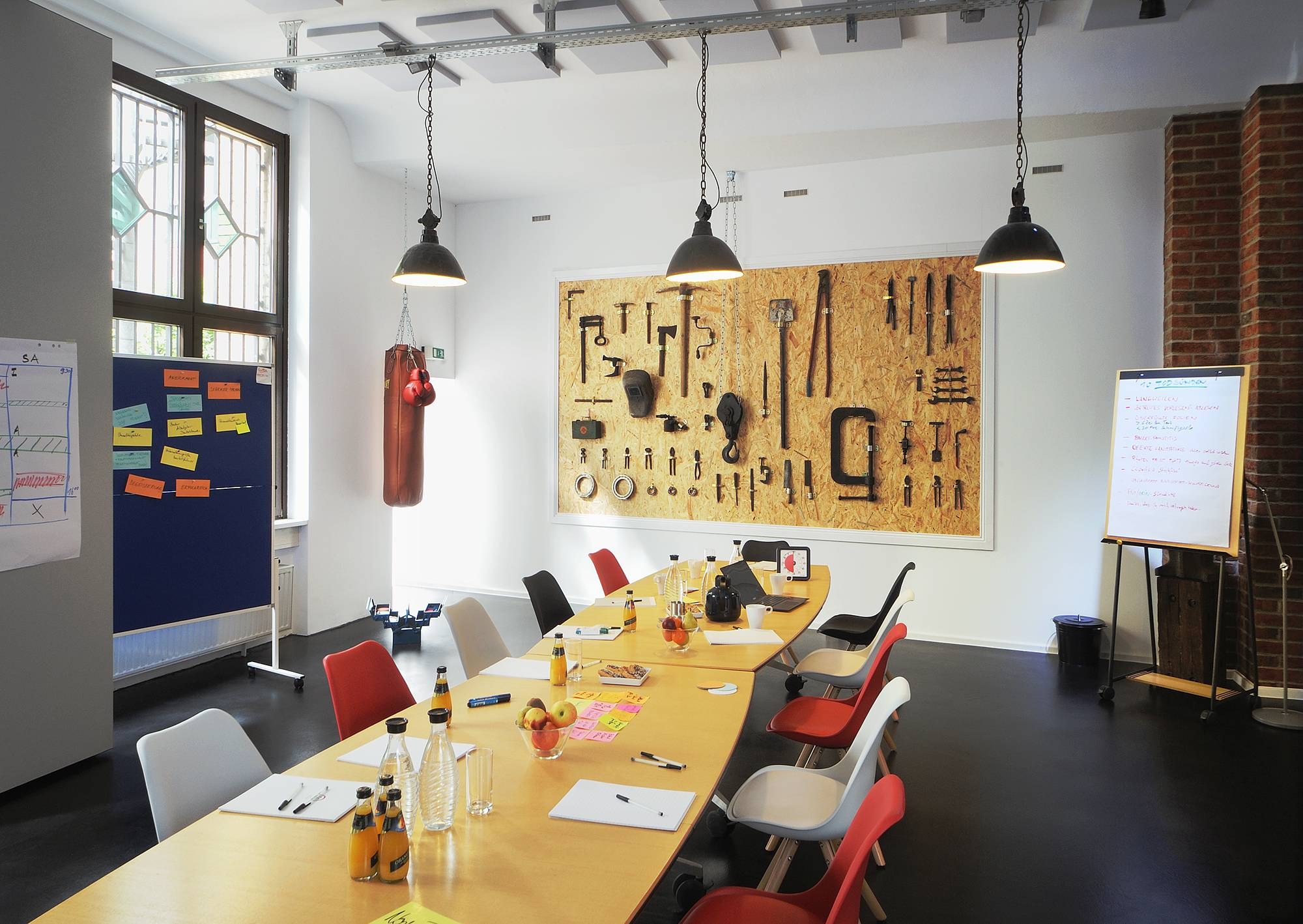 Meeet meeting room with tool wall and punch bag