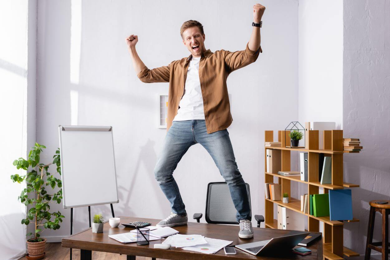 man jumping on the table in office