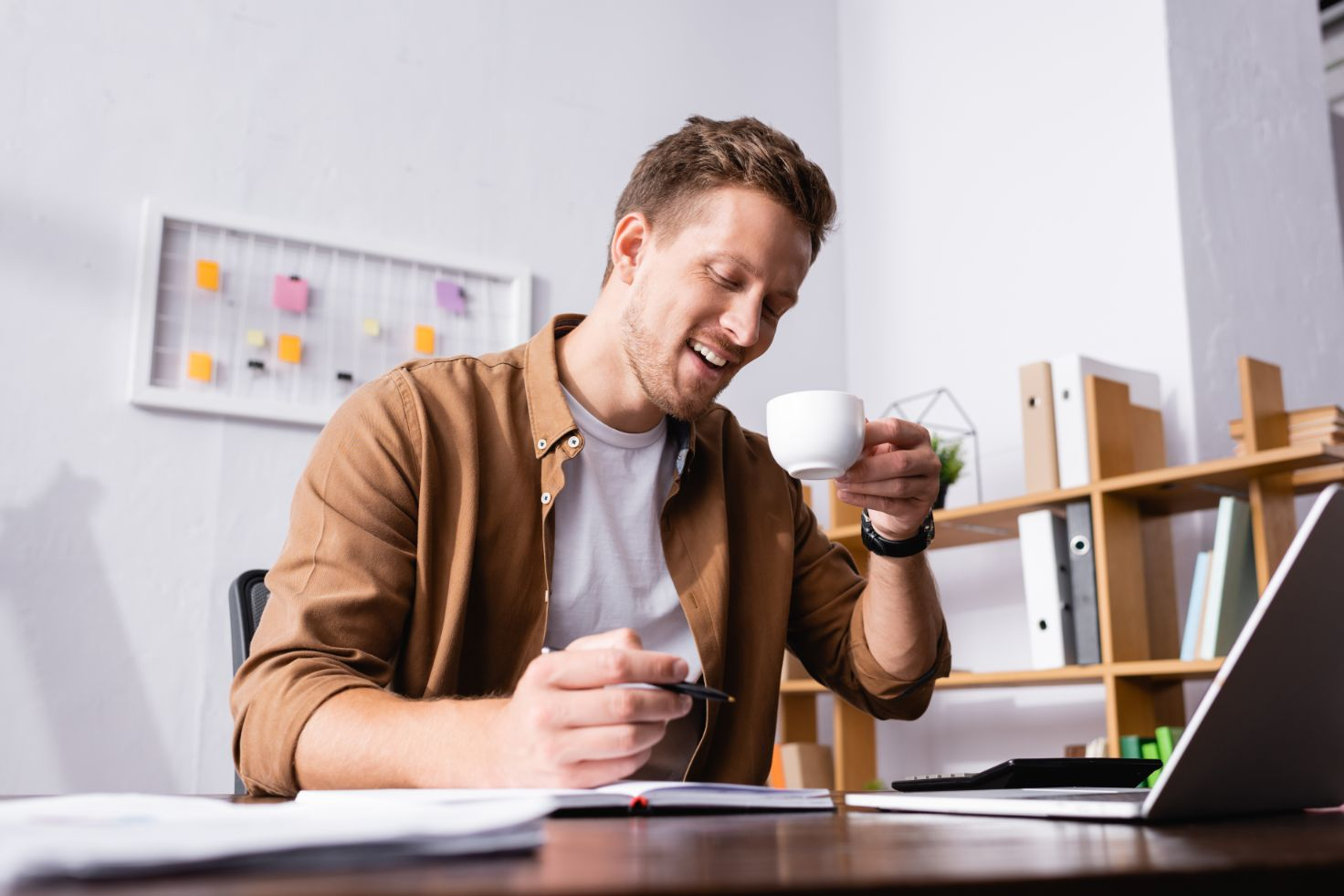 Man in office with coffee