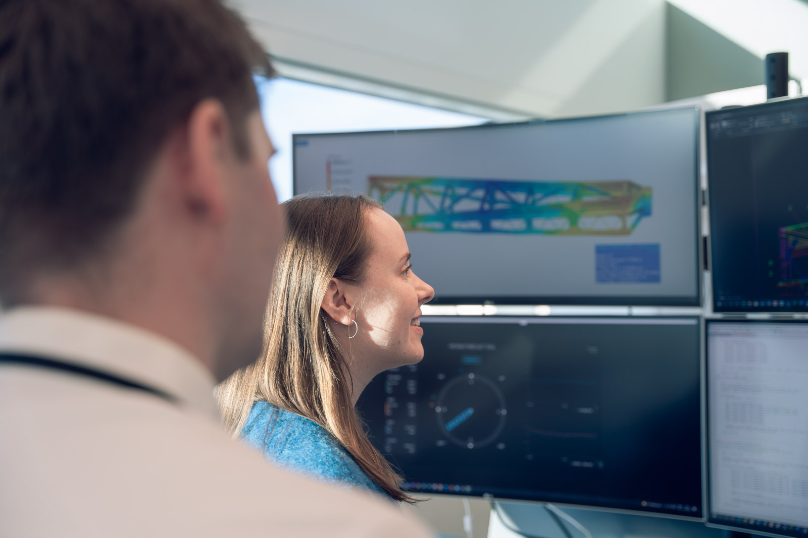 Colleagues looking at a architectural drawing on a monitor