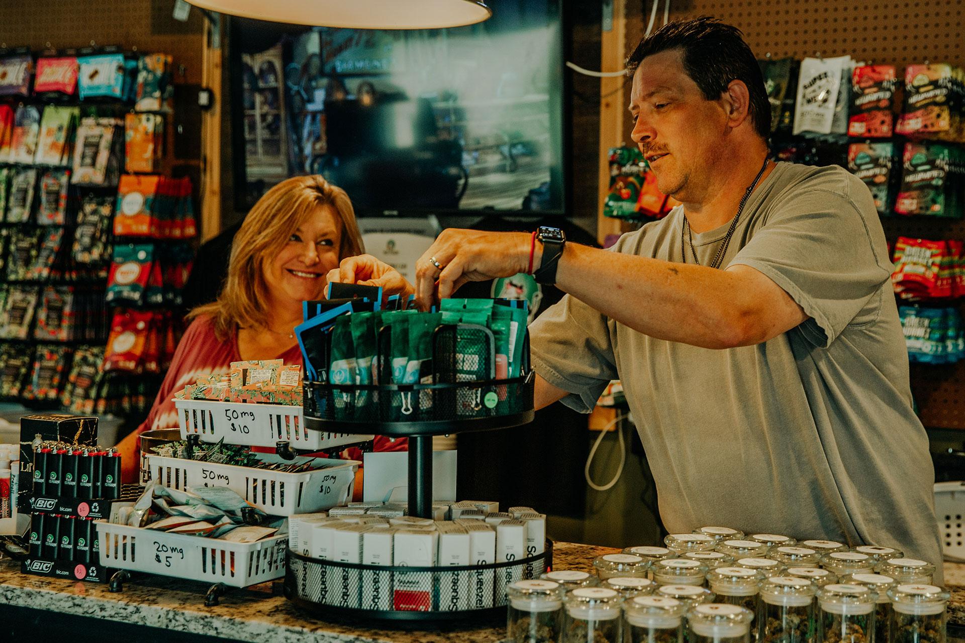 Denise and Christopher Mink doing inventory at Med Pharm OK Dispensary.