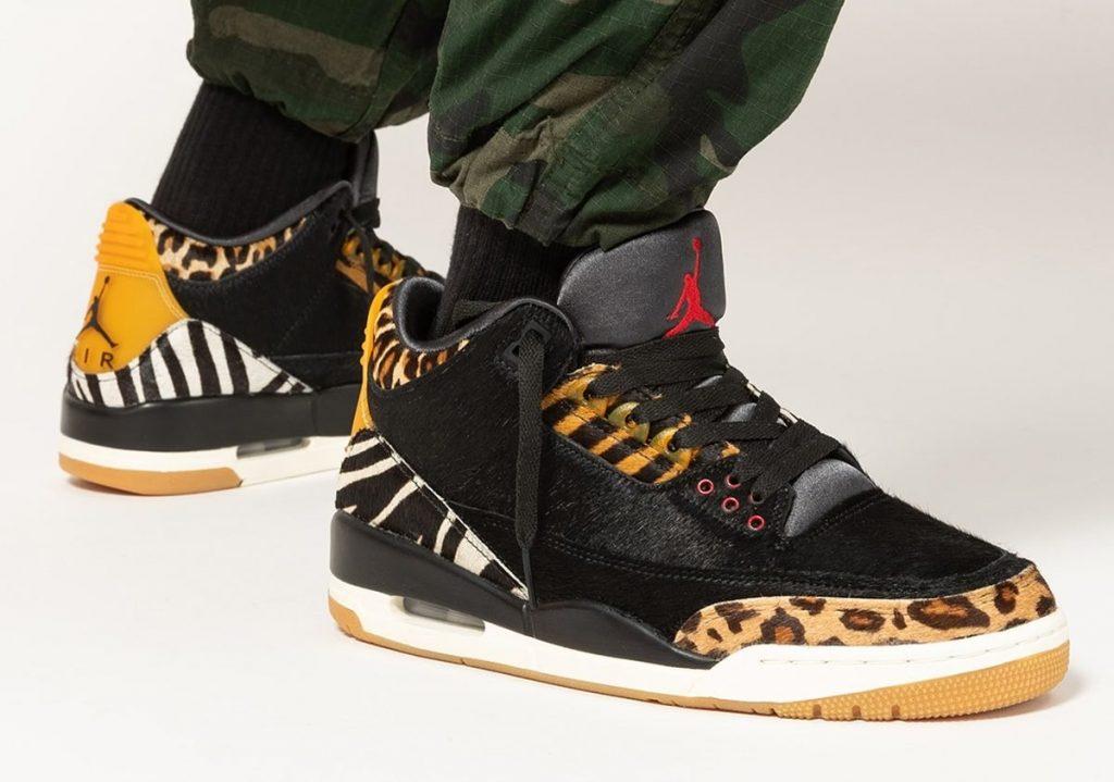 Person wearing mixed animal print Air Jordan 3 sneakers
